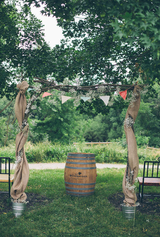 handmade wedding arch with brulap bunting and babys breath