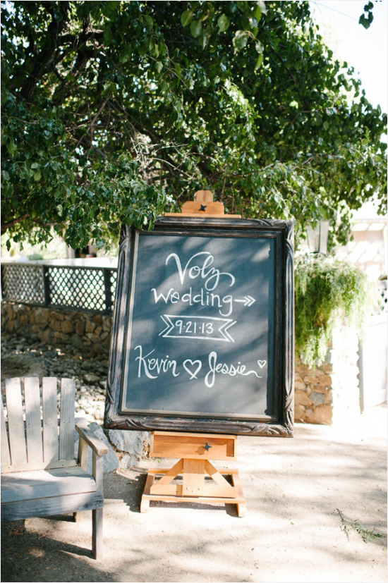 chalkboard sign to let guests know where the wedding is