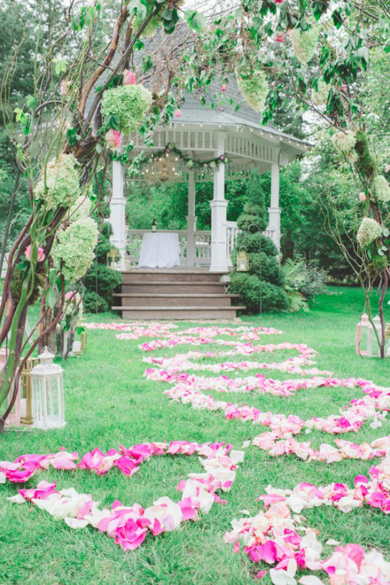 flower petals form hearts up the aisle