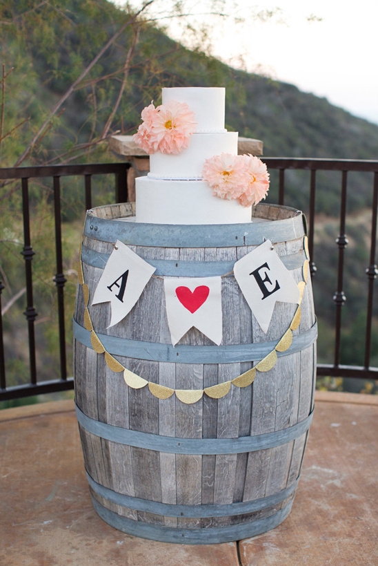use a wine barrel as a wedding cake stand