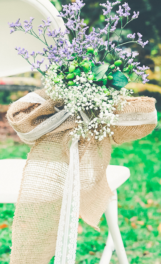 babys breath and light purple aisle decor