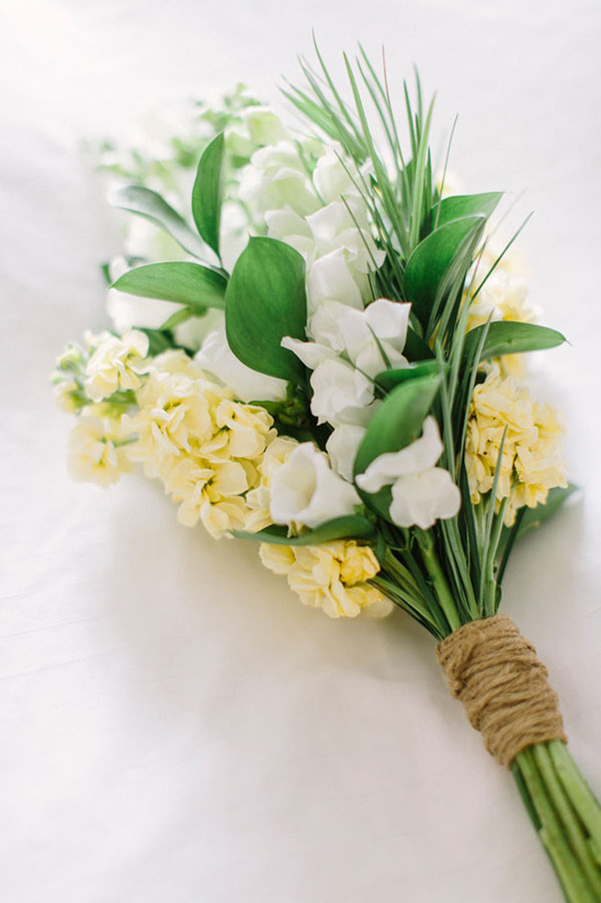 simple white and yellow bouquet wrapped with twine