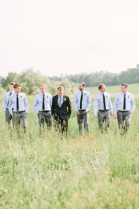 groomsmen in blue button downs and black ties