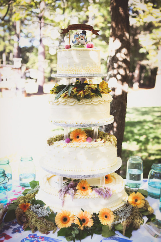 flower draped tiered wedding cake