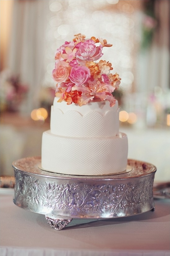 pink floral topped wedding cake