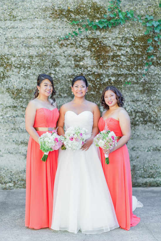 coral bridesmaid dresses with gold belts