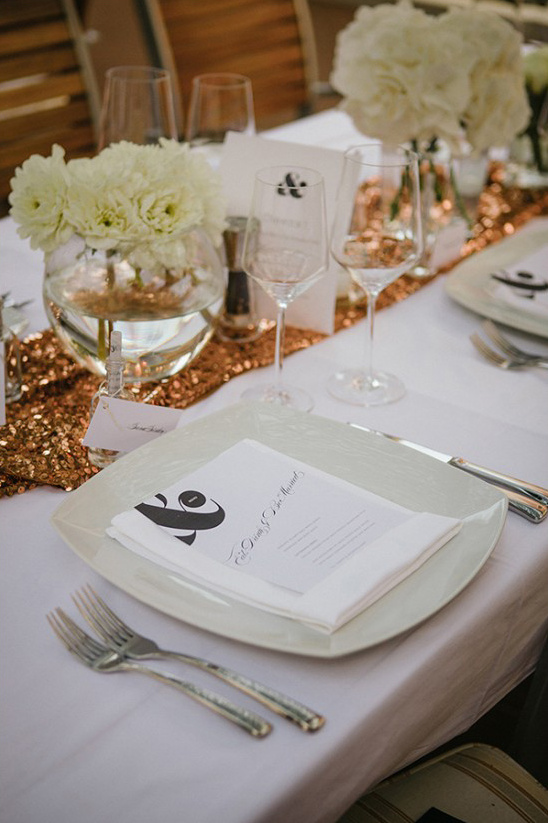 gold table runners and white floral centerpieces
