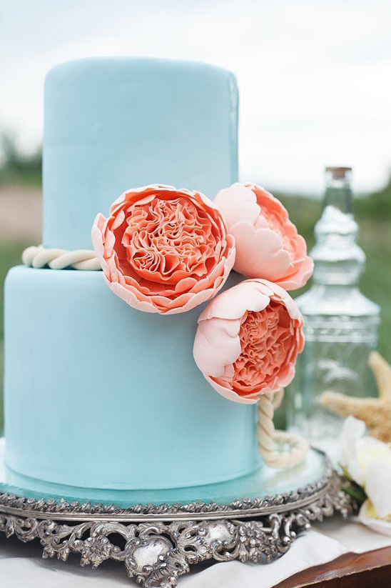 blue wedding cake with peach flowers