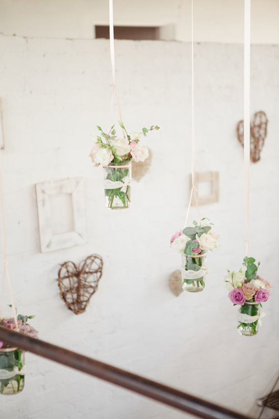 hanging floral and photo frame backdrop