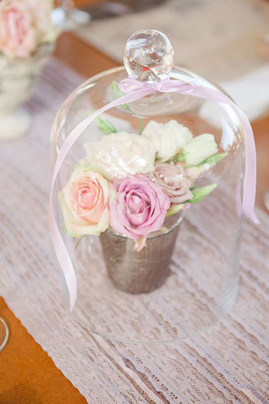 rose arrangement under glass