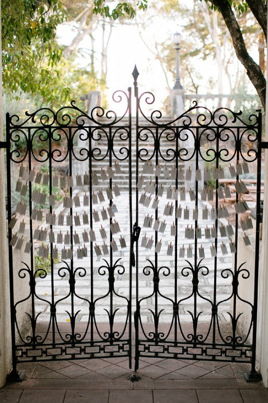 escort cards hung on a gate