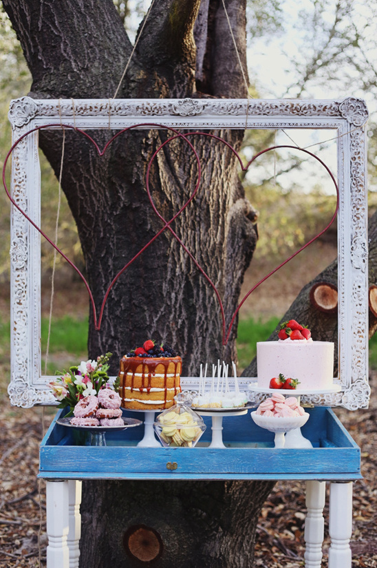 dessert table with framed hearts backdrop