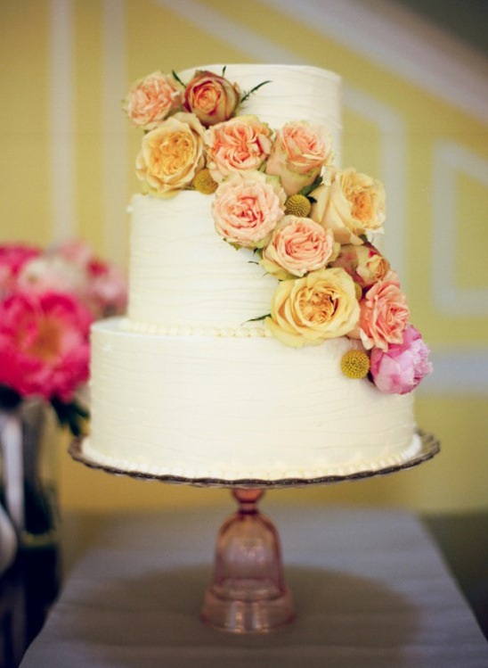 yellow and pink cascade flower wedding cake