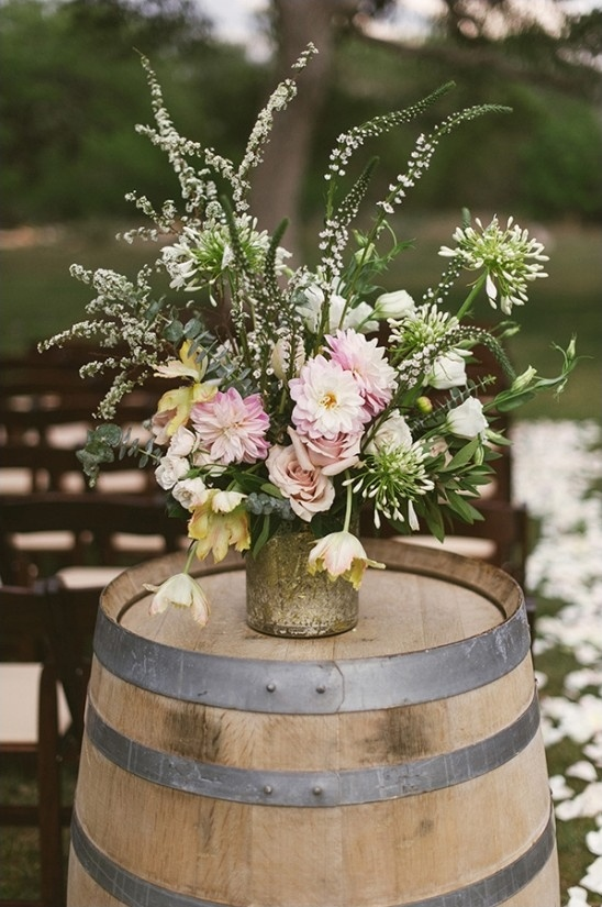 gorgeous aisle floral decor on barrel