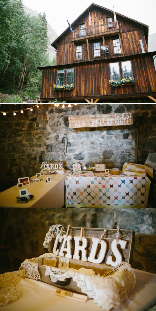 reception welcome table with guest quilt
