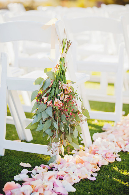 rose petals and hanging floral aisle decor