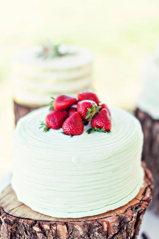 strawberry topped green wedding cake