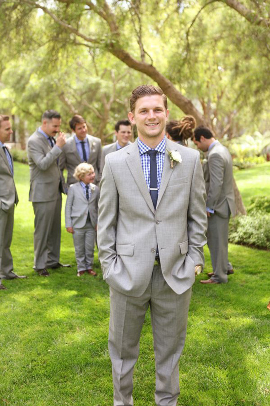 grey suit with blue checkered shirt groom look