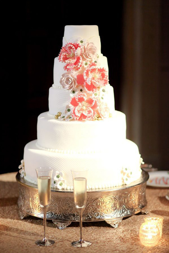white tiered wedding cake with floral accents