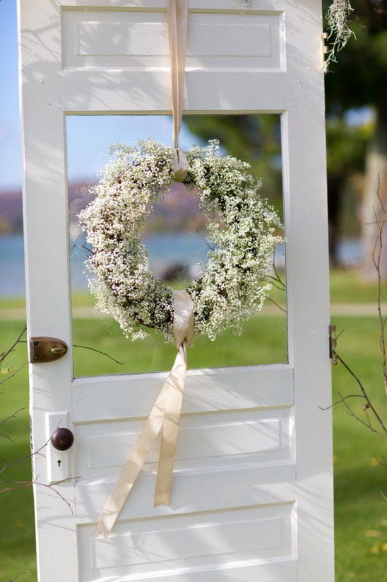 babys breath wreath on door