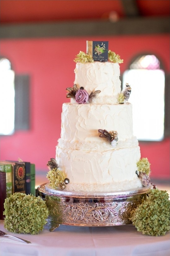 hydrangea and book topped wedding cake