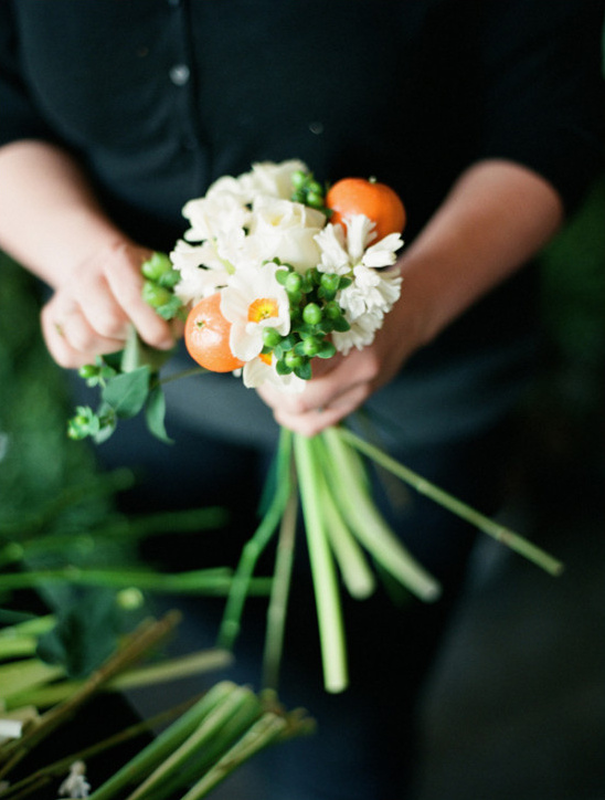 white and orange bouquet assembly