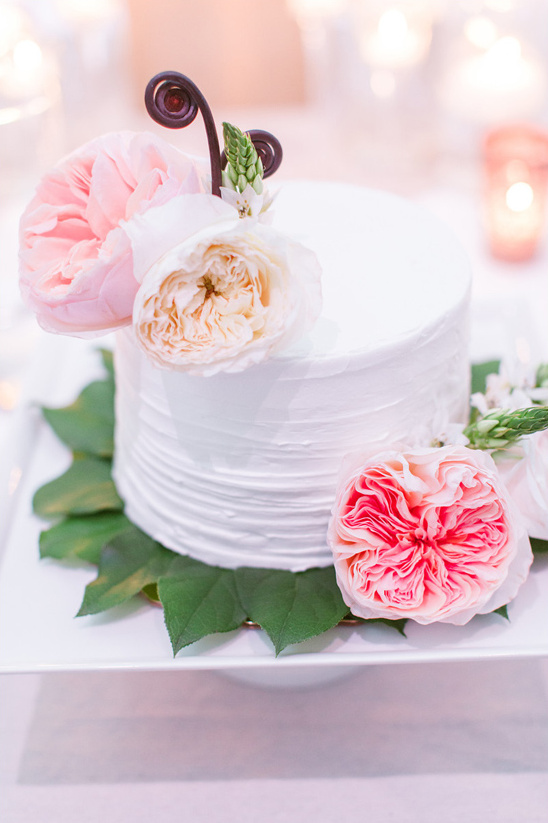 simple wedding cake with garden rose accents