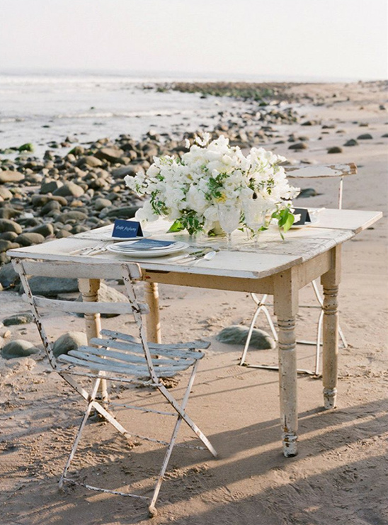 sweetheart table at beach wedding