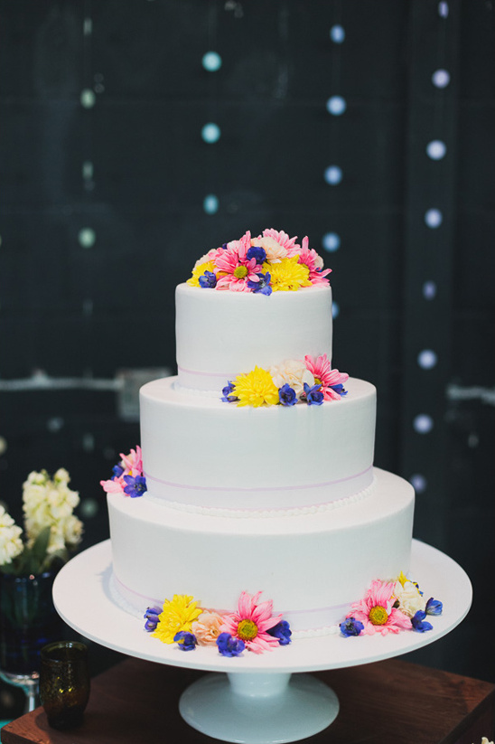 simple white wedding cake with floral accents