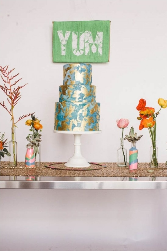 gold leaf wedding cake with DIY backdrop sign
