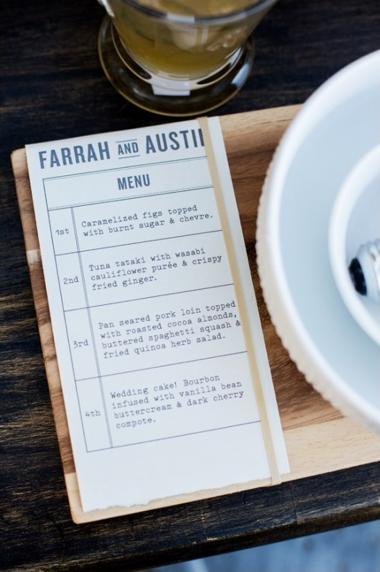wooden plank placemats with rubberbanded menu attached