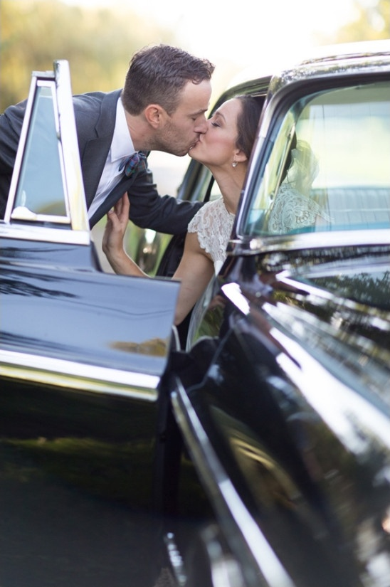 classic car wedding kiss