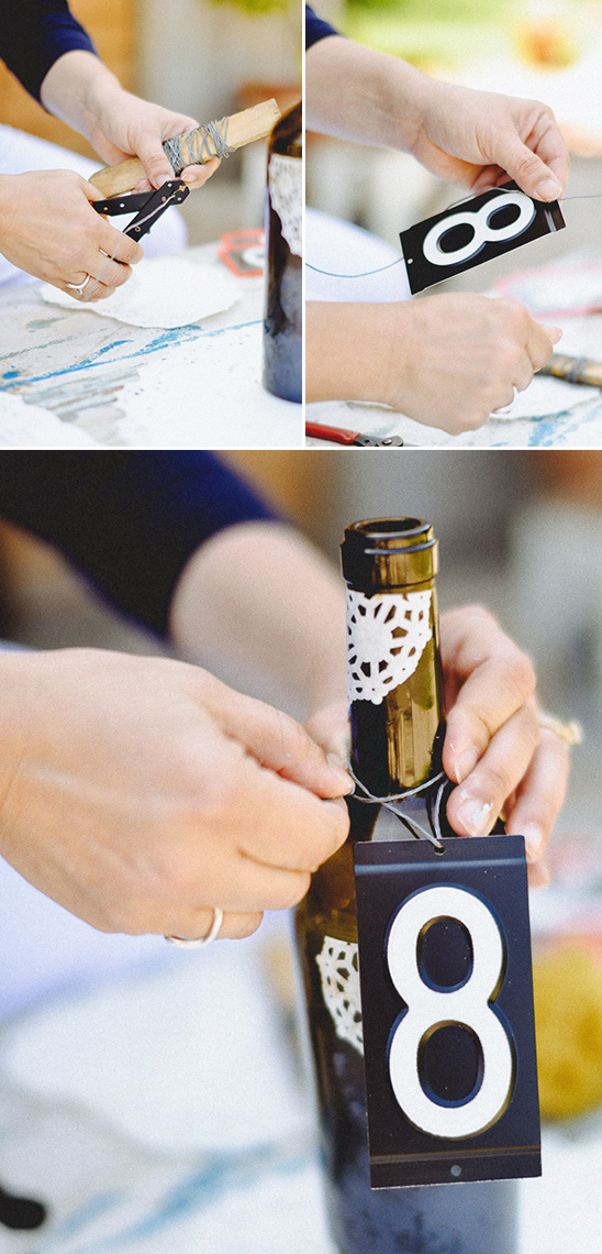 hang number around bottle using wire