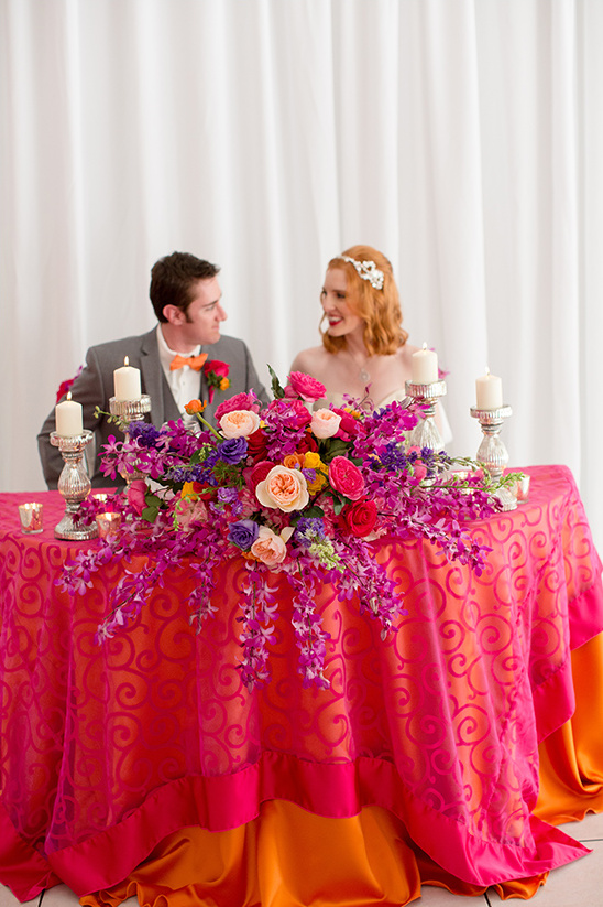 pink and orange sweetheart table