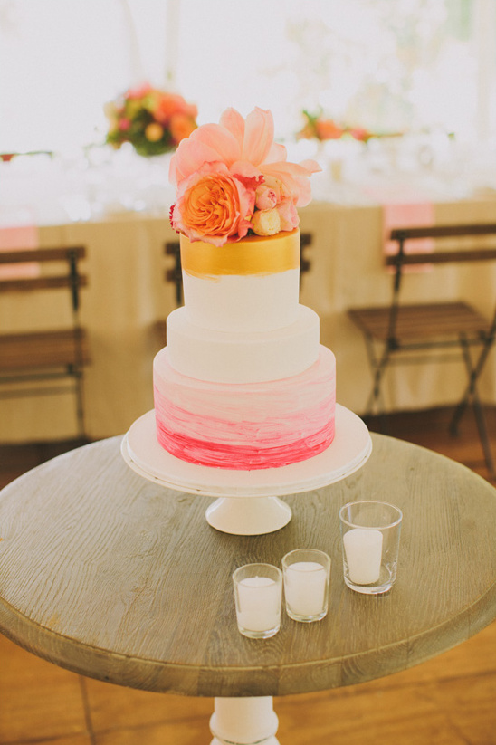 gold and pink floral topped wedding cake