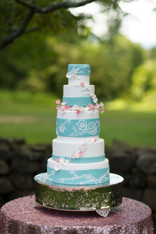 blue and white wedding cake with cherry blossoms