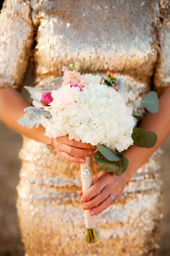 glittery gold bridesmaid dress with white and pink bouquet