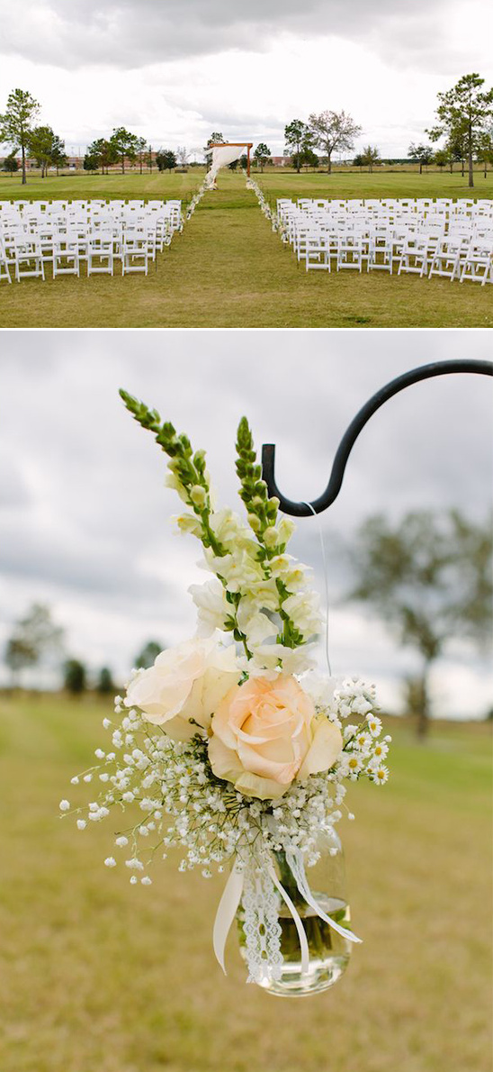 classic ceremony seating with hanging floral decor