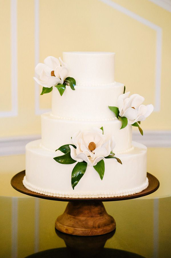 white flower accented wedding cake