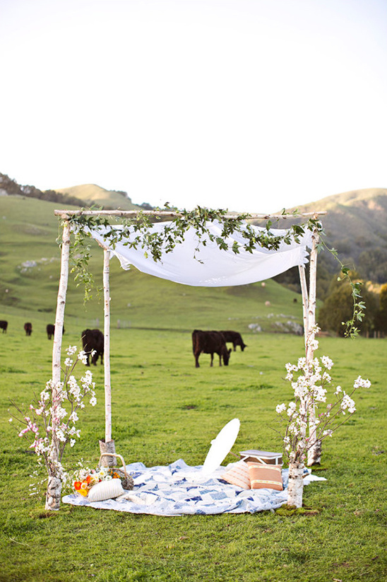 picnic style chuppah in a field