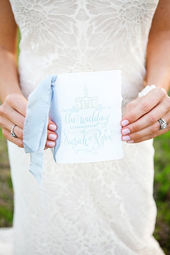 ripped edged wedding programs with ribbon