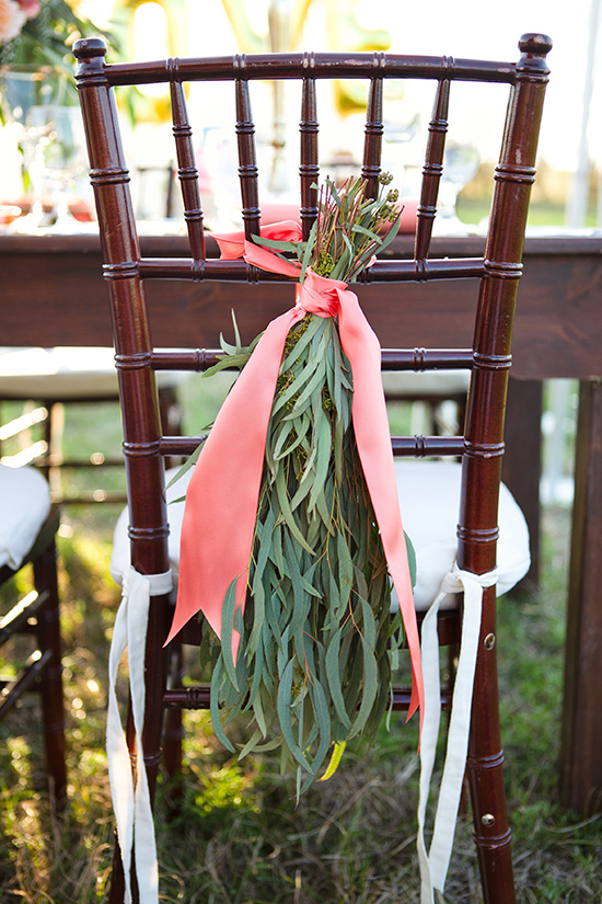 hanging greenery and ribbon chair decor