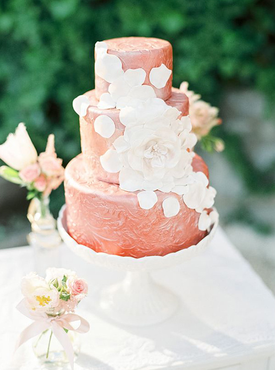 dark blush wedding cake with cascading petals