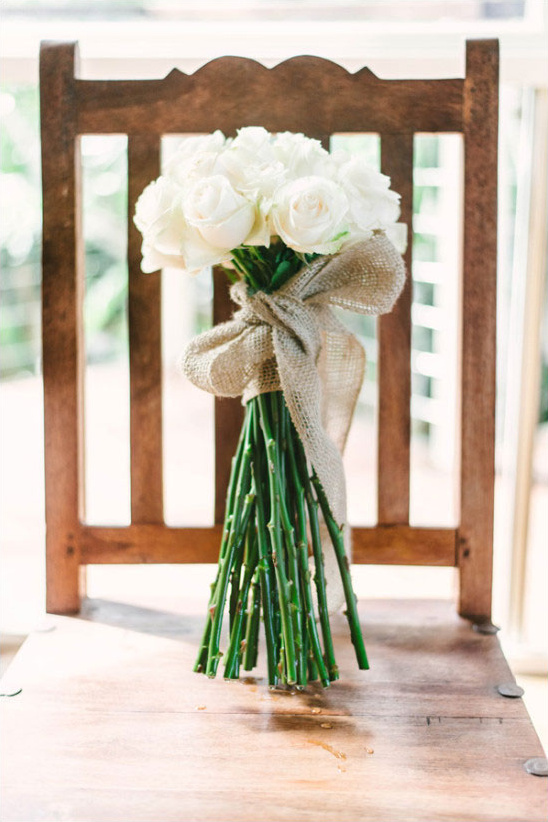 long stem white rose bouquet tied with burlap