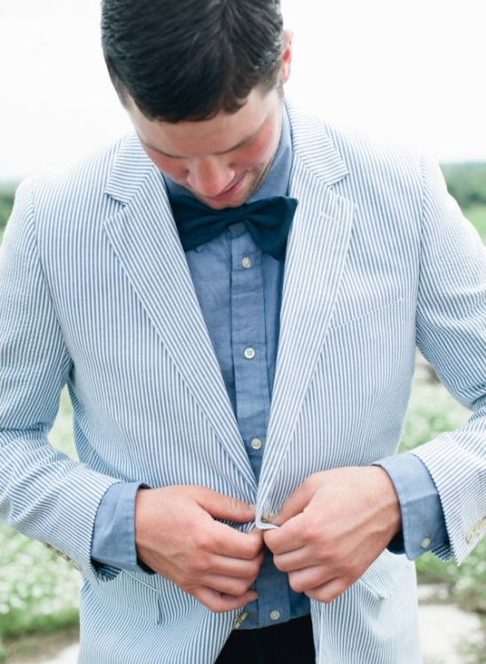 light blue pin stripped jacket denim shirt and bow tie groom
