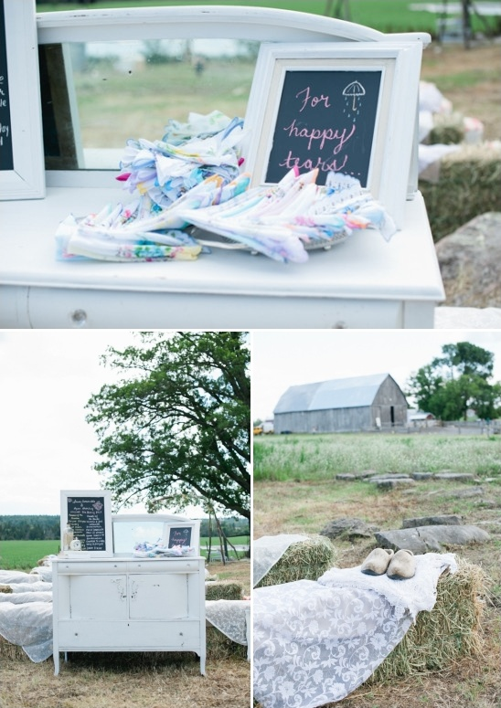 antique dresser turned welcome table and lace covered haybales for seating