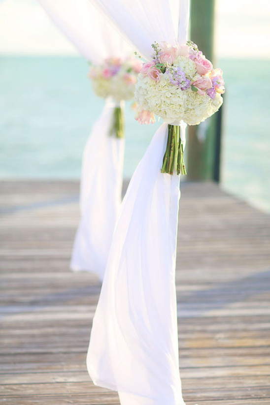 floral bouquet decor on wedding arch