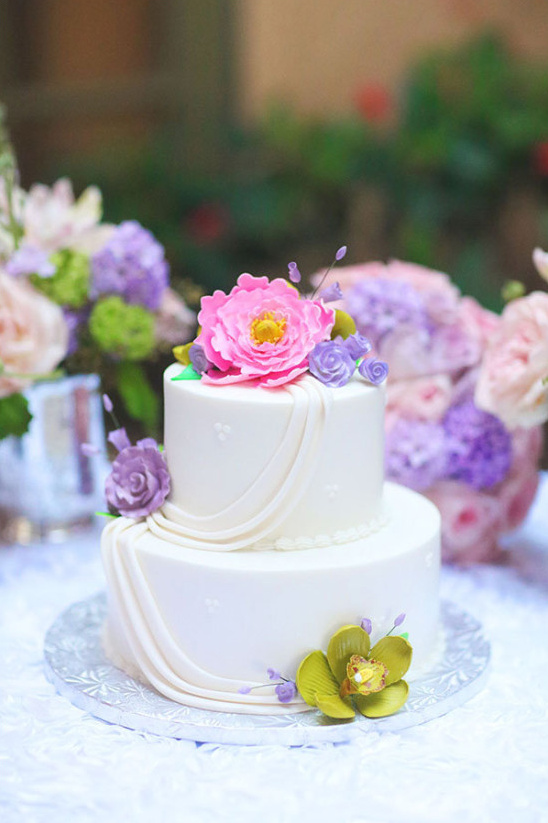 pink and purple accented wedding cake