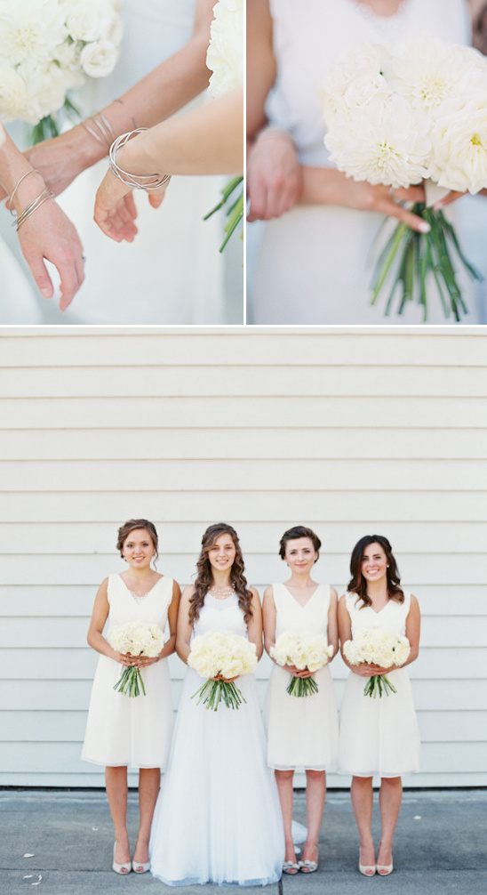 bridesmaids in white with silver bangels