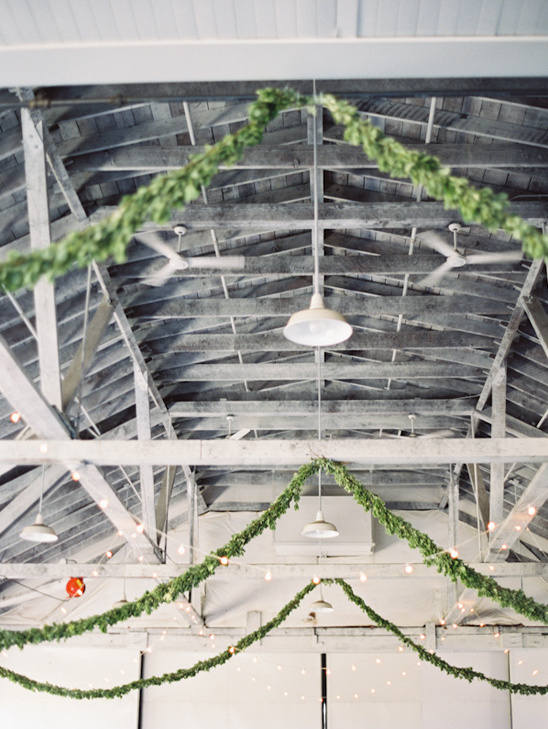 garlands and string lights to decorate a large industrial space